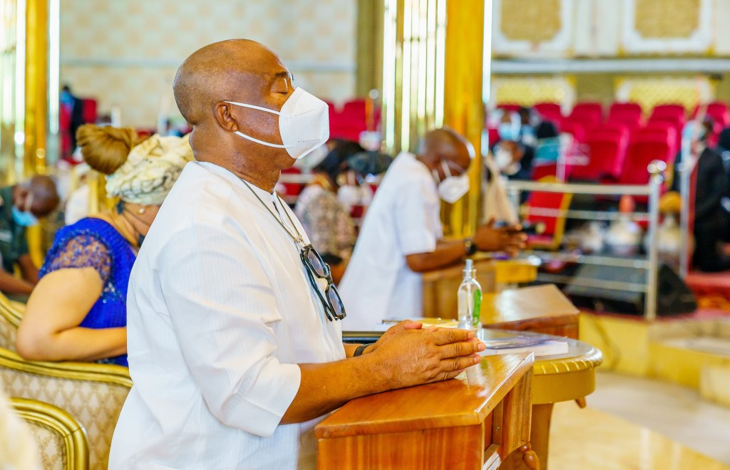 Imo State Governor, Hope Uzodinma praying in a church
