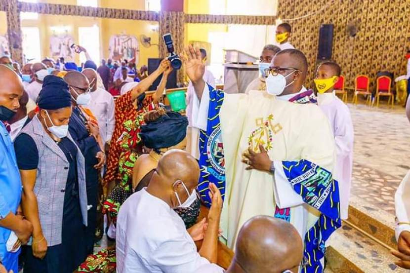 GOVERNOR HOPE UZODINMA IN CHURCH DURING EASTER MASS