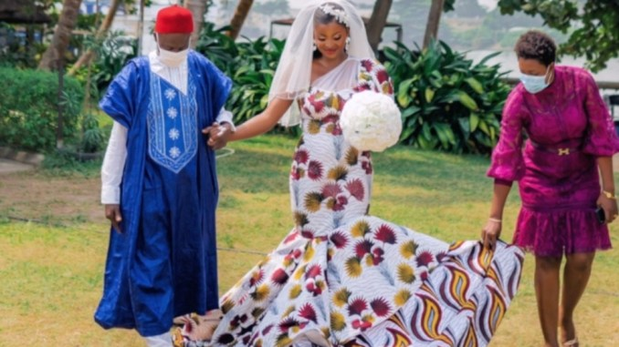 Nigerian fashion designer satisfies her desire, wears an Ankara gown on her wedding day - 9News Nigeria