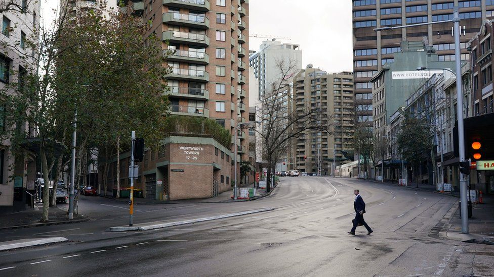 image captionStreets in central Sydney were near deserted on Monday morning