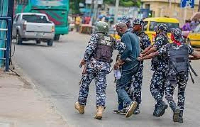 Nigerian Police officers arrest a Yoruba Nation protester