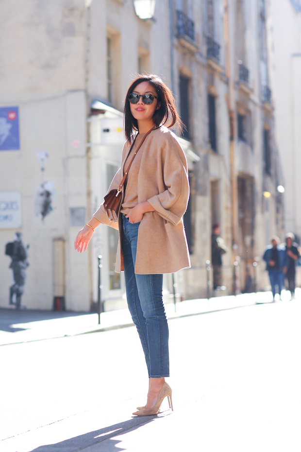 Lady wearing thigh length robe style coat