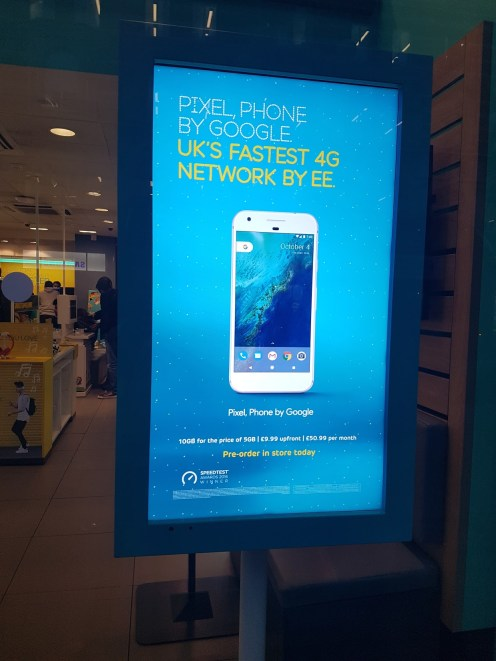 "This is a ""standard"" ad outside one of EE's store. This is Oxford Street, however, where literally thousands of people walk by every day."