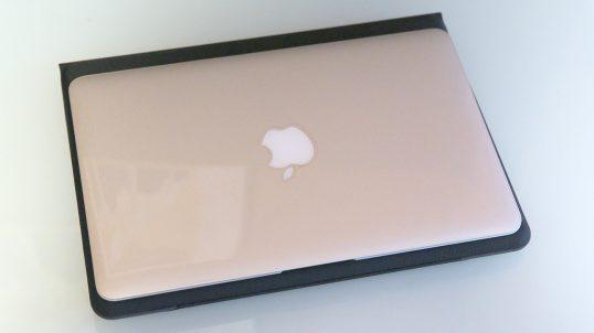 "iPad Pro in keyboard case underneath MacBook Air 11"""