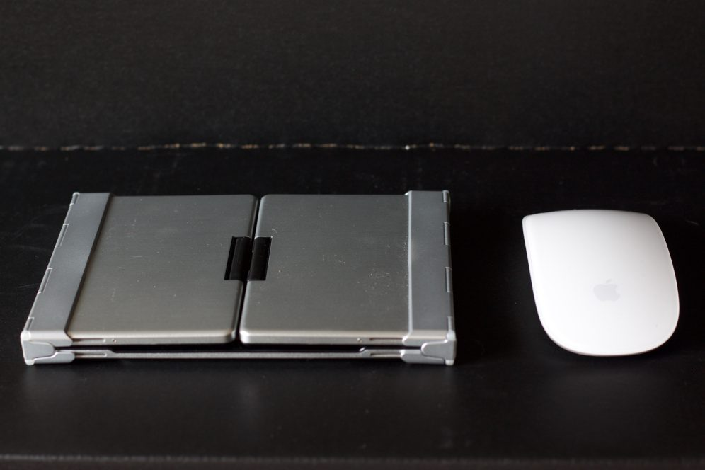 iClever Tri-Folding Backlit Bluetooth Keyboard - Folded next to Magic Mouse