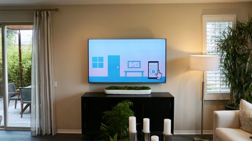 The TV in the open living space draws attention to the connected home features