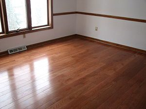 A room with wood flooring made of oak.