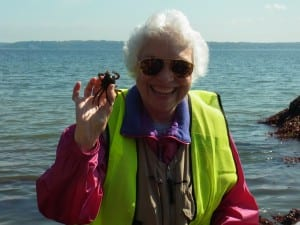 Beach Naturalist Maradel Gale shows a small kelp crab on a prior beach exploration