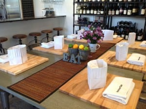 At the Intentional Table, in Winslow, your chef's hat and cutting board are ready for the hands-on cooking class with fresh Farmers' Market picks.
