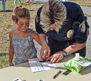 "At last year's Night Out, face-painting and ""fingerprinting"" were two of the activities offered by Bainbridge Island police officers at National Night Out"