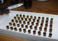 Filling cannabis oil capsules AKA canna caps source: BeyondChronic.com
