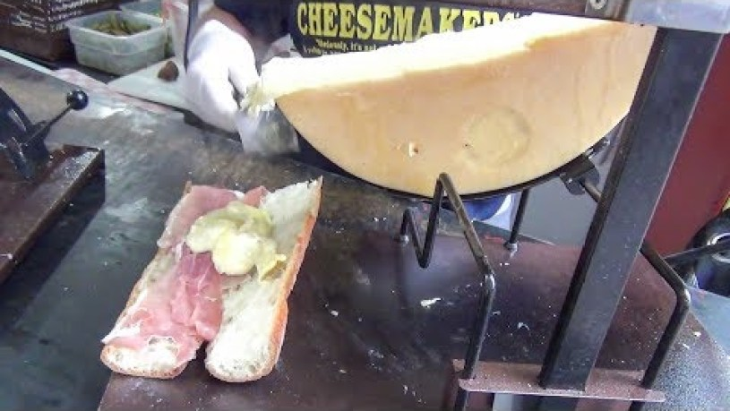New York Street Food. Yummi Swiss Raclette. Ham, Hot Dog, Sausage with Soft Warm Cheese