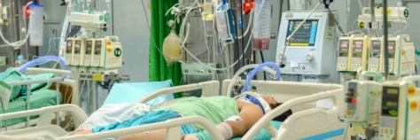 Patient with  life saving equipment for treatment in ICU at the hospital.