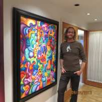 Eric Nye with his vivid colored painting named Venice Beach