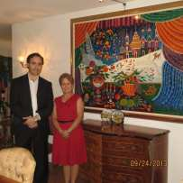 Realtors Allen Fox and Jean Ward from @PROPERTIES next to Yuri Gorbachev's Painting hard edged n 24 Carat liquid gold of President Gorbachev's home in St. Petersburg Russia