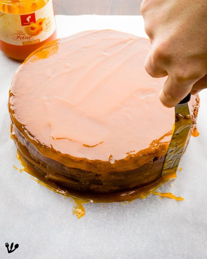 Coat the Sacher cake all over with an excellent apricot jam. Let set in the refrigerator for a couple of hours. If you think your cake could use even more jam, coat a second time and let set again.