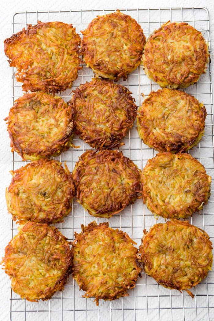 You can keep the latkes warm in the oven, or even reheat them, but they will taste best fresh out of the skillet.