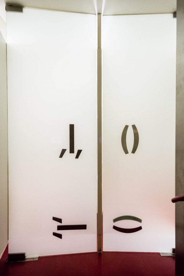 """""""Curious"""" signs on the doors of the restroom at the Café Korb, where Freud used to meet with his Wednesday Society."""