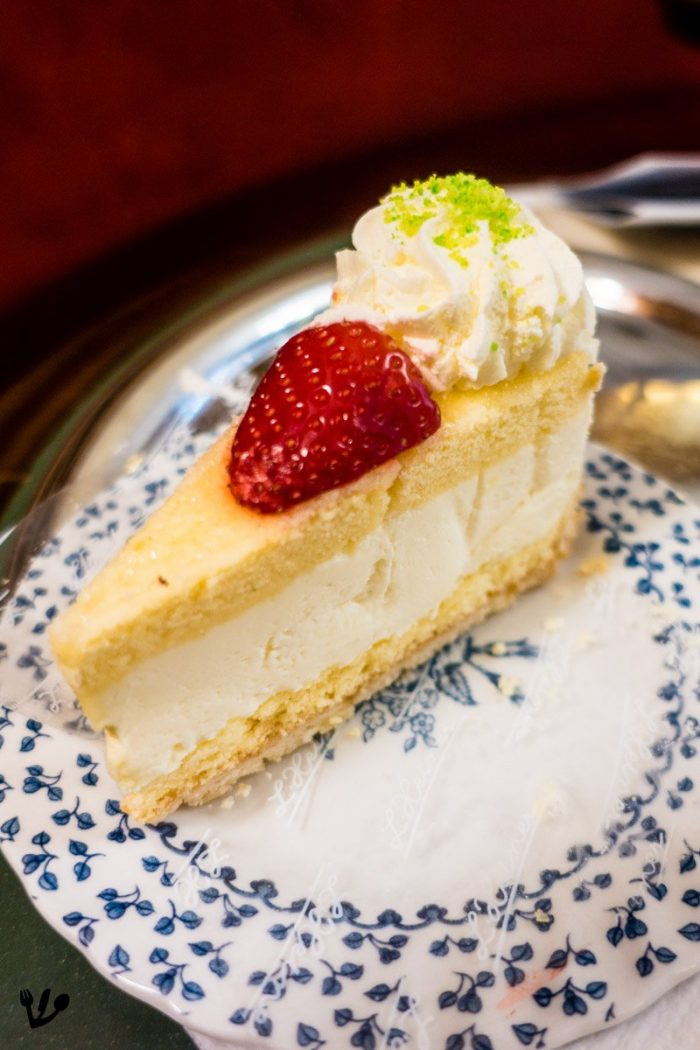 """This classic Topfenoberstorte (whipped-cream cheesecake) has a Viennese crust (""""Wiener Boden"""") which is a bit firmer but also finer in texture than regular biscuit (sponge cake). Here at the fabulous pastry shop K&K Hofzuckerbäckerei Heiner in Wollzeile 9 (Vienna)."""