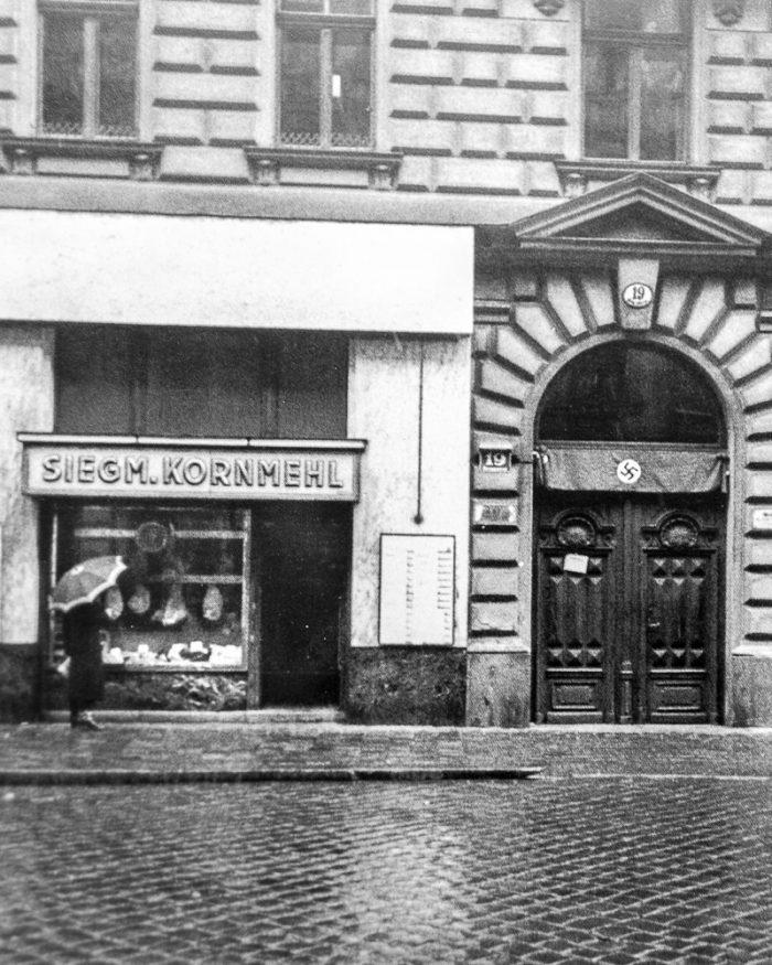 "If you look closely you can see what appears to be shanks of ham and speck hanging in the window of Siegmund Kornmehl's butcher shop at Berggasse 19 in Vienna. This is a crop from a well-known photograph by Edmund Engelman taken in May 1938, a couple of weeks after the ""Anschluß,"" the annexation of Austria into Nazi Germany on March 12. After 44 years at this address, this shop too was ""Aryanized""."