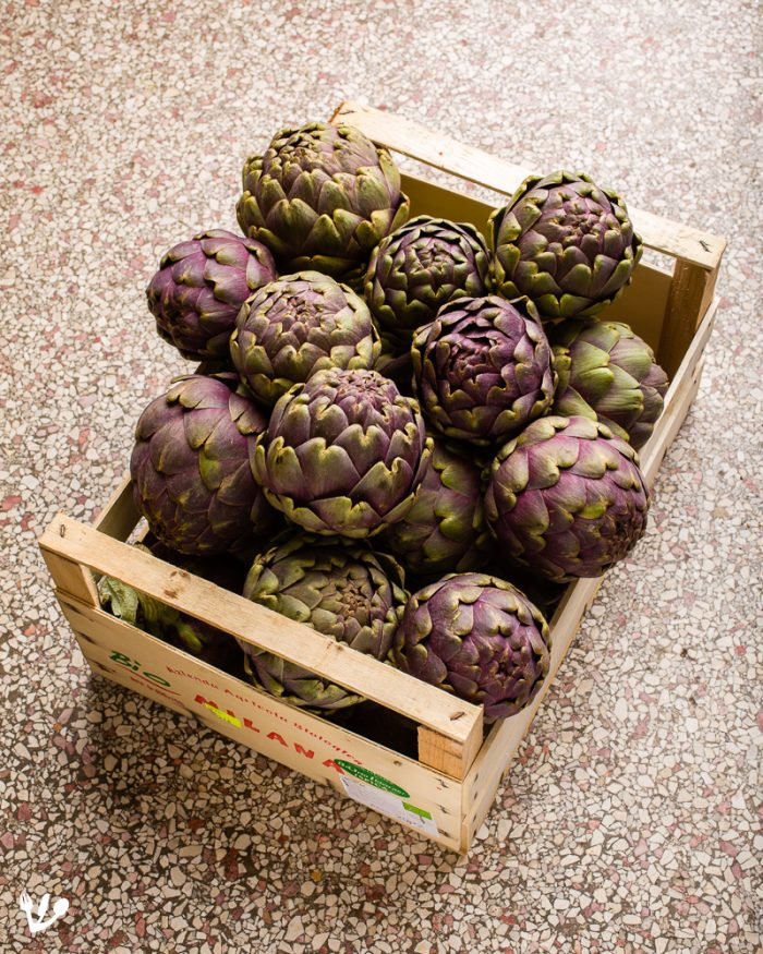 """<em>You can never get enough artichokes. Most of the flower gets peeled away anyway, and then you and your guests will end up eating far more than you would have imagined. Here's another crate of organic carciofi</em>bought at <a href=""""http://www.BioMartin.at"""" target=""""_blank"""" rel=""""noopener"""">BioMartin</a>'s market stall."""