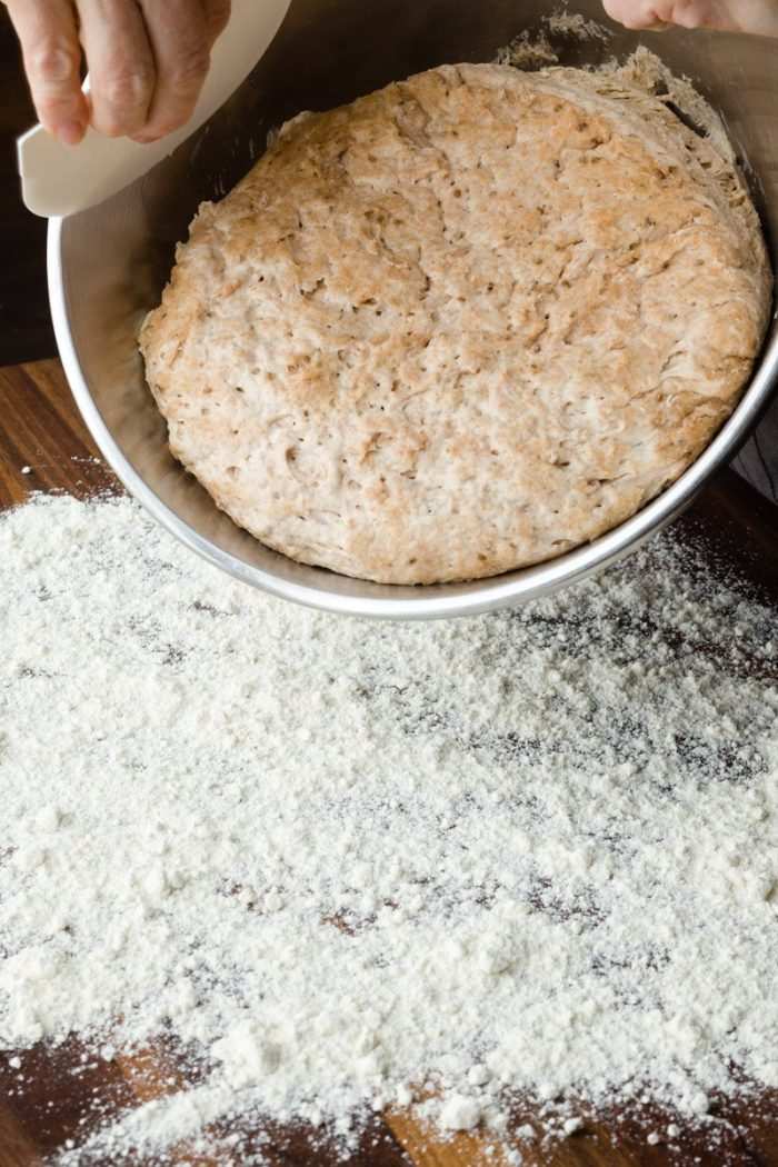 Place the dough on a very well floured surface, sprinkled with more seeds of the spice mix for this no-knead bread.