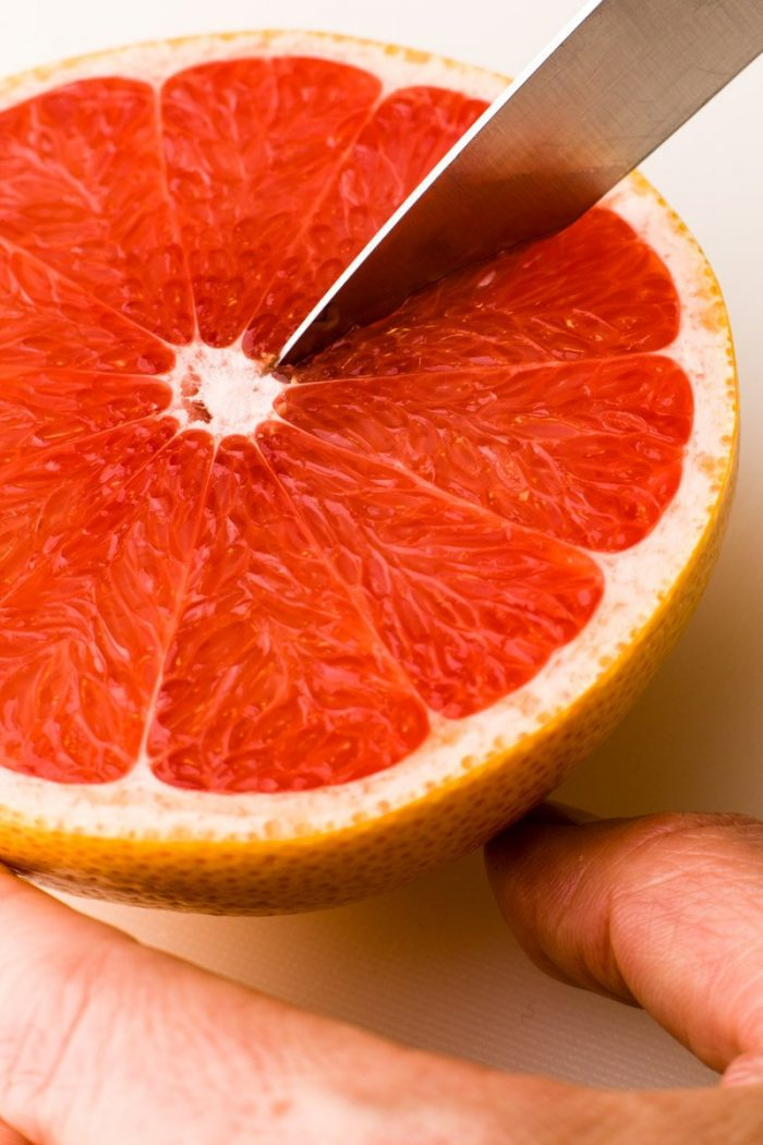 """Loosen grapefruit segments with a sharp paring knife (best <a href=""""https://www.amazon.com/gp/product/B005LRYE36/ref=s9_acsd_top_hd_bw_b1DP9_c_x_2_w?pf_rd_m=ATVPDKIKX0DER&amp;pf_rd_s=merchandised-search-4&amp;pf_rd_r=238VM5GQXKMNMFKD9RXW&amp;pf_rd_t=101&amp;pf_rd_p=bb529486-4f43-5c23-a318-a7b3960e4ac1&amp;pf_rd_i=289859"""" target=""""_blank"""" rel=""""noopener"""">budget option</a>and my <a href=""""https://www.amazon.com/Wusthof-Classic-3-5-Paring-Knife/dp/B005YC1R24/ref=lp_289859_1_23?s=kitchen&amp;ie=UTF8&amp;qid=1485243707&amp;sr=1-23"""" target=""""_blank"""" rel=""""noopener"""">favorite</a>) by delicately following the membranes. I generally don't bother cutting off a thin slice of the poleto stabilize the fruit, because that just makes it easier to pierce the skin and loose the wonderful juice."""