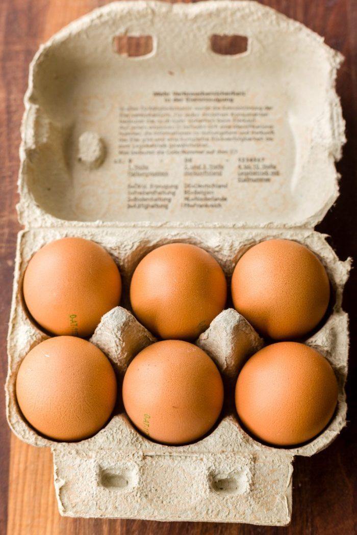6 local, organic, non-GMO, pasture-raised eggs in a recycled carton.