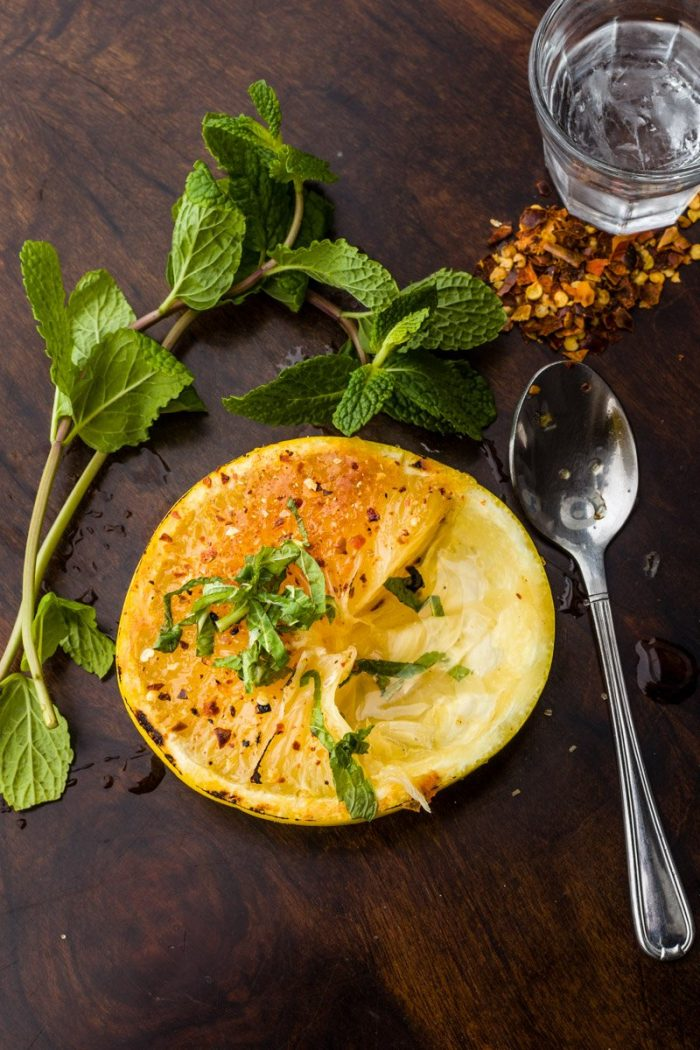 """This delicious Paul Gauguin-inspired, faux Caribbean version of the grapefruit brûlée builds on the combination of caramelized sugar and salt, white grapefruit, Tequila or<a href=""""https://www.curacaoliqueur.com/"""" target=""""_blank"""" rel=""""noopener"""">Senior Curaçao</a> and chili flakes, topped with a chiffonade of mint leaves."""