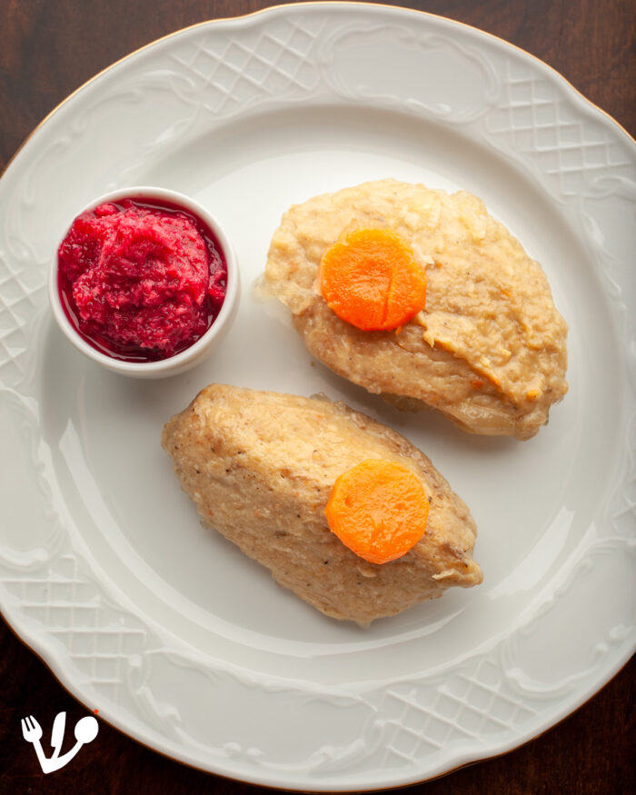 """These are the """"gefilte fish"""" patties, or carp quenelles, with red """"chrain,"""" sweet beet horseradish relish, on the side. They freeze very well, so we always make a batch for later use."""