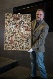 Josh Levine holds Jackson Pollock gouache painting (Photo courtesy of J. Levine Auction & Appraisal)