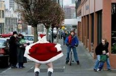 More disturbing Santa, a funny Christmas picture of Santa flashing people on the street.