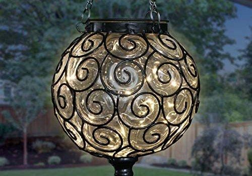 Exhart Solar Hanging Lantern, Handblown Clear Glass – Round Hanging Lantern Light w/ 12 LED Firefly String Lights, Metal & Glass Lantern Decorative Orb for Outdoor Décor (7in l x 7in w x 20in h)