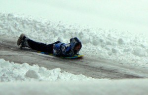 Sledding down the street