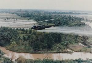 US-Huey-helicopter-spraying-Agent-Orange-in-Vietnam