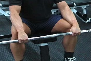 seated-reverse-wrist-curl-barbell-down.jpg