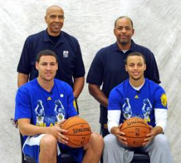 The Golden State Warriors team photographer takes a portrait of  Golden State Warriors players Klay Thompson, seated left and Stephen Curry, and their fathers former National Basketball Association players, Mychal Thompson, standing left and Dell Curry before the start of the SplashBrothers Clinic held at the Golden State Warriors training facility in Oakland, Calif., on Friday, Sept. 20, 2013. The clinic, presented by Kaiser Permanente, offered participants a basketball experience with Stephen Curry, Klay Thompson, and their fathers, Dell and Mychal. Proceeds from the event go to the Warriors Community Foundation. (Doug Duran/Bay Area News Group)