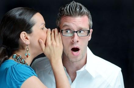 Women gossiping to men