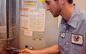 United Plumbing - Gas-Line-Installation-in-Springfield-Missouri-image of repairman working on an interior gas line