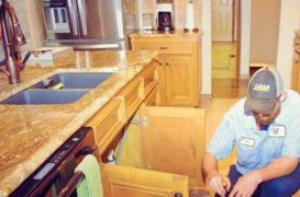 United Plumbing Springfield MO-faucet repair - image of repairman working on a kitchen faucet