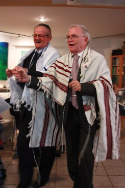 Rabbi leading Henryk to his first Aliya