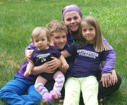 The writer with her 3 kids, including Emmelle