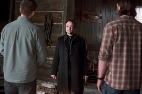 Dean and Sam Winchester talk to Crowley