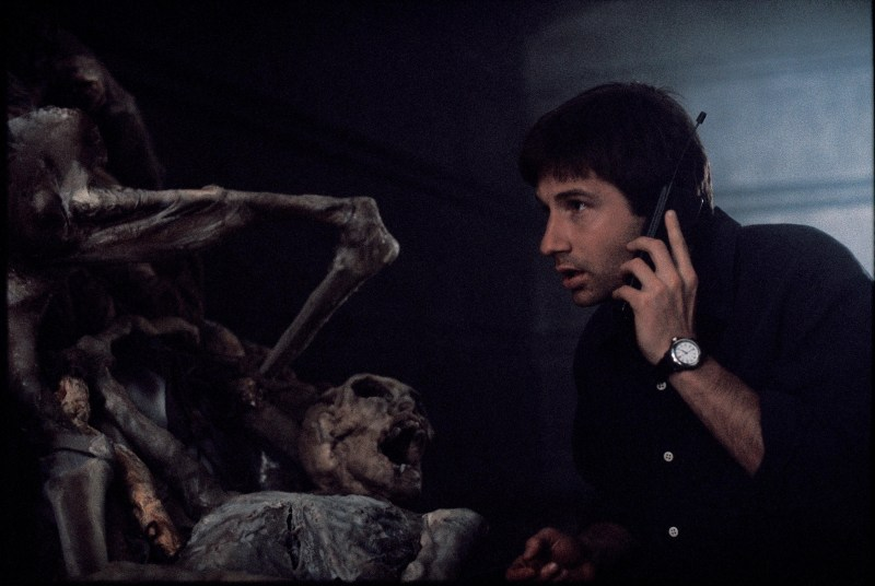 Mulder inspects evidence of an alien conspiracy.