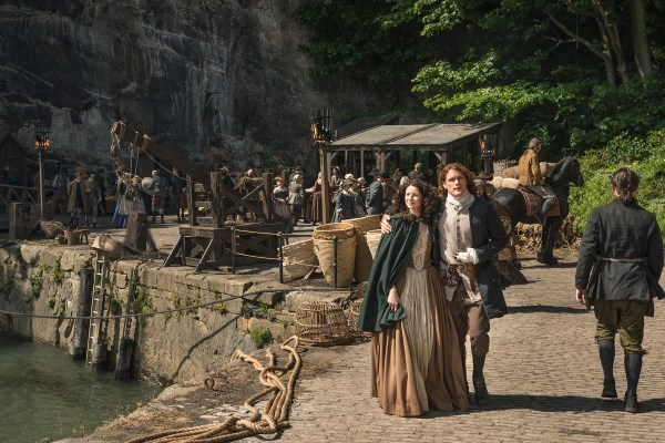 Claire and Jamie taking a stroll, plotting the dismantling of a rebellion. You know, normal things. (Courtesy Starz)