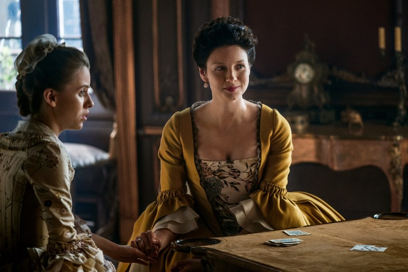 Claire sitting with Mary King. Sadly, I don't think Claire (Caitriona Balfe) is going to get out of this one by playing an electric guitar.