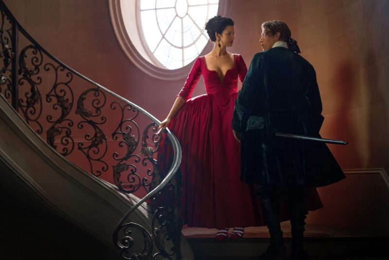 Scottish clothes may be less fancy but at least King Louis won't be there. (On left, Claire Fraser and on right, Sam Heughan as Jamie Fraser.)