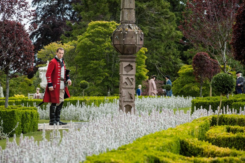 Jack Randall stands in a garden. Killing Jack Randall would also be pretty sweet. #Iamjustsaying