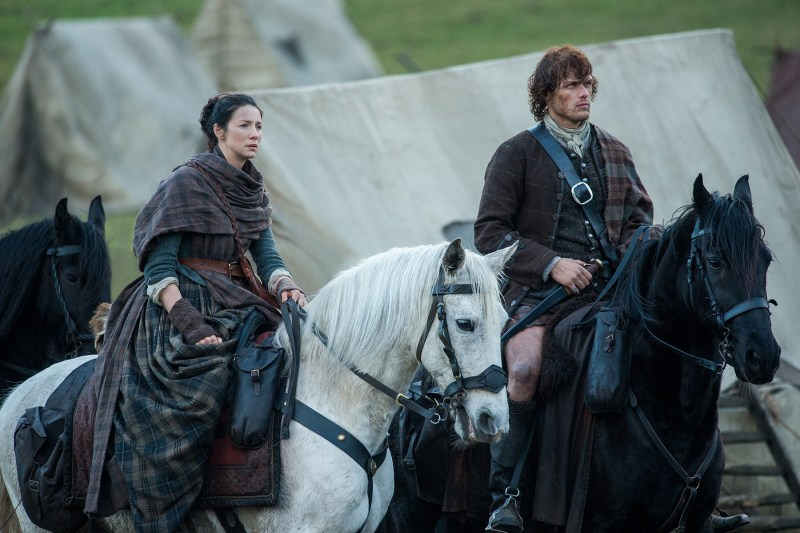Look, I get that you need food and whatever. But can we get our priorities straight here? (Left, Caitriona Balfe as Claire Fraser. Right, Sam Heughan as Jamie Fraser.)