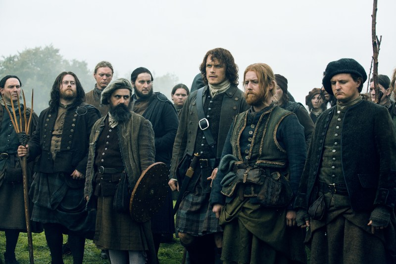 Besides becoming an actual Jacobite. (Jamie, standing with his Jacobite men.)